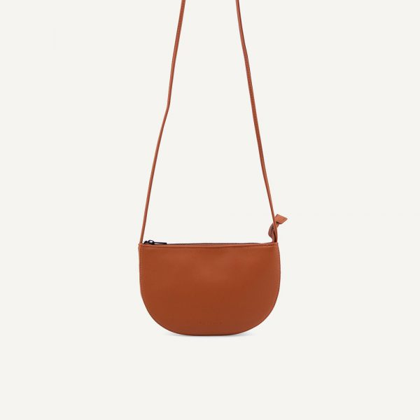 Monk & Anna: Farou half moon bag | pebbled PU | Burnt orange